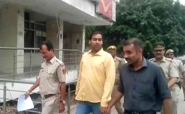 AAP MLA Manoj Kumar Being taken into the custody under police escort. Image source: NDTV