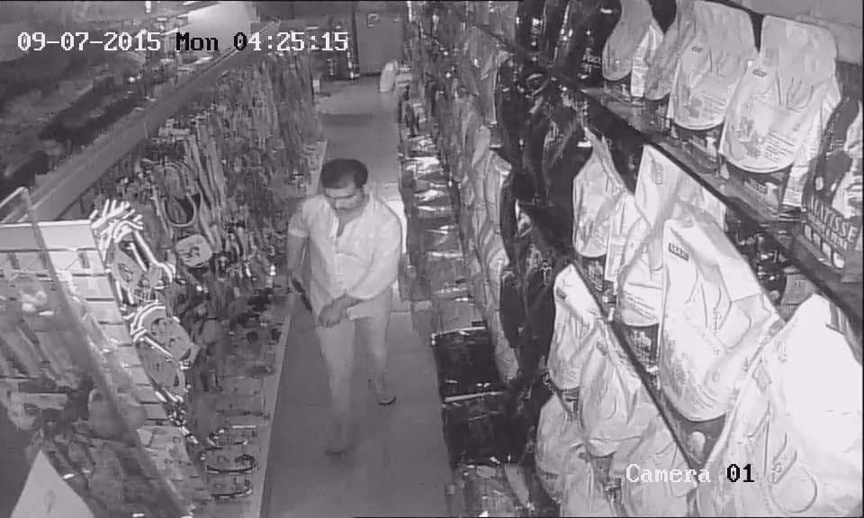 Another Image of Robber caught in CCTV camera taking round into the store at Porvorim