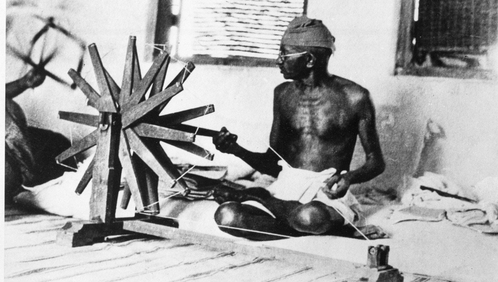 Bapuji (Mahatma Gandhi is busy waving khadi)